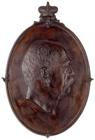 Head in profile right, in cast-iron frame with crown above.