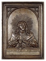 In Gothic arch, Christ sitting with his right hand raised, in his left hand a piece of bread.