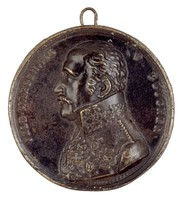 Bust in profile left in Prussian general's uniform with several medals including the Order of the Black Eagle, the Iron Cross, and the National Order of Merit.