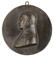 Cast iron portrait medallion modeled in high relief with the image of Gebhard Leberecht Blücher, Prince of Wahlstatt (1742-1819), Prussian field marshal, in profile left in Prussian general's uniform with military medals including the Iron Cross, the National Order of Merit, and the Order of the Black Eagle.