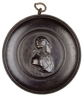 Bust in profile right in uniform with sash, in cast iron frame.