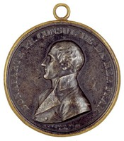 Bust in profile left in civilian dress in contemporary brass frame.