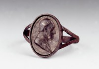 Large cast-iron ring, the ribbed band with split shoulder, the face with an oval portrait medallion with the bust of Christoph Martin Wieland (1733-1813) in profile right.