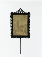 The rectangular frame with pierced foliate motifs and scrolling foliage at the finial. The lithophane with a Rhenish church.