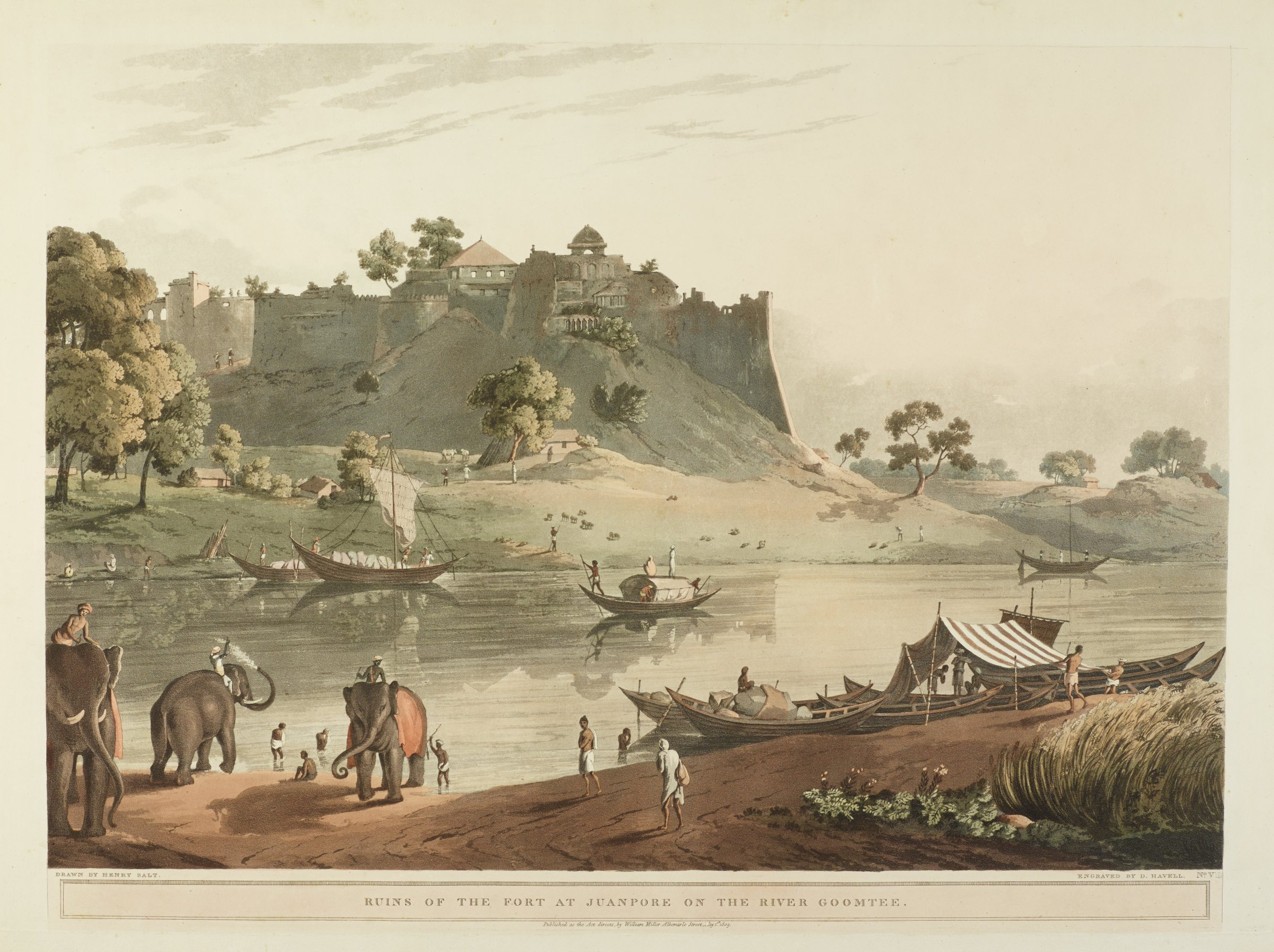 On the bank of a river, boats line the water's edge. Elephants stand on the right. People are scattered throughout the composition. In the background stands the ruins of a fortress.