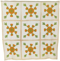 Nine orange and green circular designs with four sassafras leaves placed evenly around circle; each design within a square outlined by light brown strips.