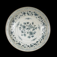 Glazed stoneware with chrysanthemums and cloud patterns in well, floral scrolling below rim and scrolling on rim, all painted in underglaze cobalt oxide blue.