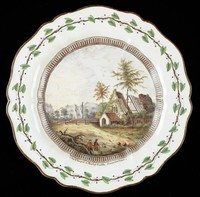 """Colorful round dessert plate of """"Catherine"""" shape edged in brown enamel, the rim decorated with a border of green ivy leaves and berries on a vine, the interior well encircled with a band of brown gadrooning and painted with a view of the ruins of the chapel at Farleigh Hungerford Castle in Somerset, England, within a natural landscape with two male figures in the foreground, below the scene """"The Chapel in Fairley Castle, Somersetshire"""""""