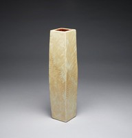 Tall, simple, narrow vase of porcelain, the clay subtly marbleized in shades of brown and tan and given an irregular surface texture that spans the central part of the body and which resembles a rough textile-like pattern, the interior glazed brown.