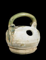Lime pot of glazed stoneware with molded and applied decoration of green areca vine handle and nuts
