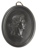 Oval medallion of black basalt with the bas relief portrait of Roman Emperor Julius Caesar (100-44 BC) facing right, wearing laurel leaf crown, self frame, pierced to hang.