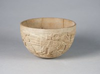 Bowl with figures wearing masks and feather headdresses
