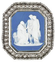 Octagonal brooch or buckle comprised of a dark blue jasper medallion with white jasper bas relief of Coriolanus – Coriolanus with his wife and mother who entreat him to return to Rome – in a cut-steel mount of faceted steel beads set in circles with an outer band of smaller faceted steel beads.