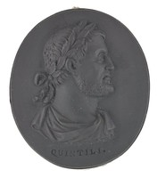Small oval medallion of black basalt with the bearded portrait bust of the Roman general and politician Quintilius draped and with laurel leaf crown facing right, below the bust impressed QUINTILI., set into a simple, tooled silver mount with an eye for a chain.