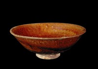 Stoneware bowl with incised chatter mark and floral pod in the well
