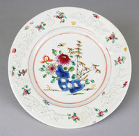 Plate decorated with raised flowers and painted flowers