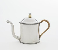 Small, simple silver invalid feeder in teapot form with an extended, curved spout that ends in a pierced bulb, the upper and lower edges of the main body with a slender band of beading, the slightly domed cover with a bone and silver knop, the loop handle covered with wicker.