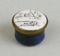 Round box with dog on cover.