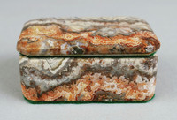 Rectangular hinged box with marble top and sides.