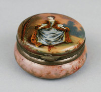 Round box with painting of a woman on the lid.