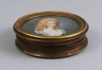 Round box with miniature painting on ivory.