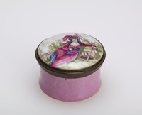 Small, round patch box of enameled copper, the box pink and the cover with a white ground and the portrait of a woman lounging in a landscape, with metal mounts.