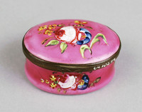 Oval box with pink raised floral design.