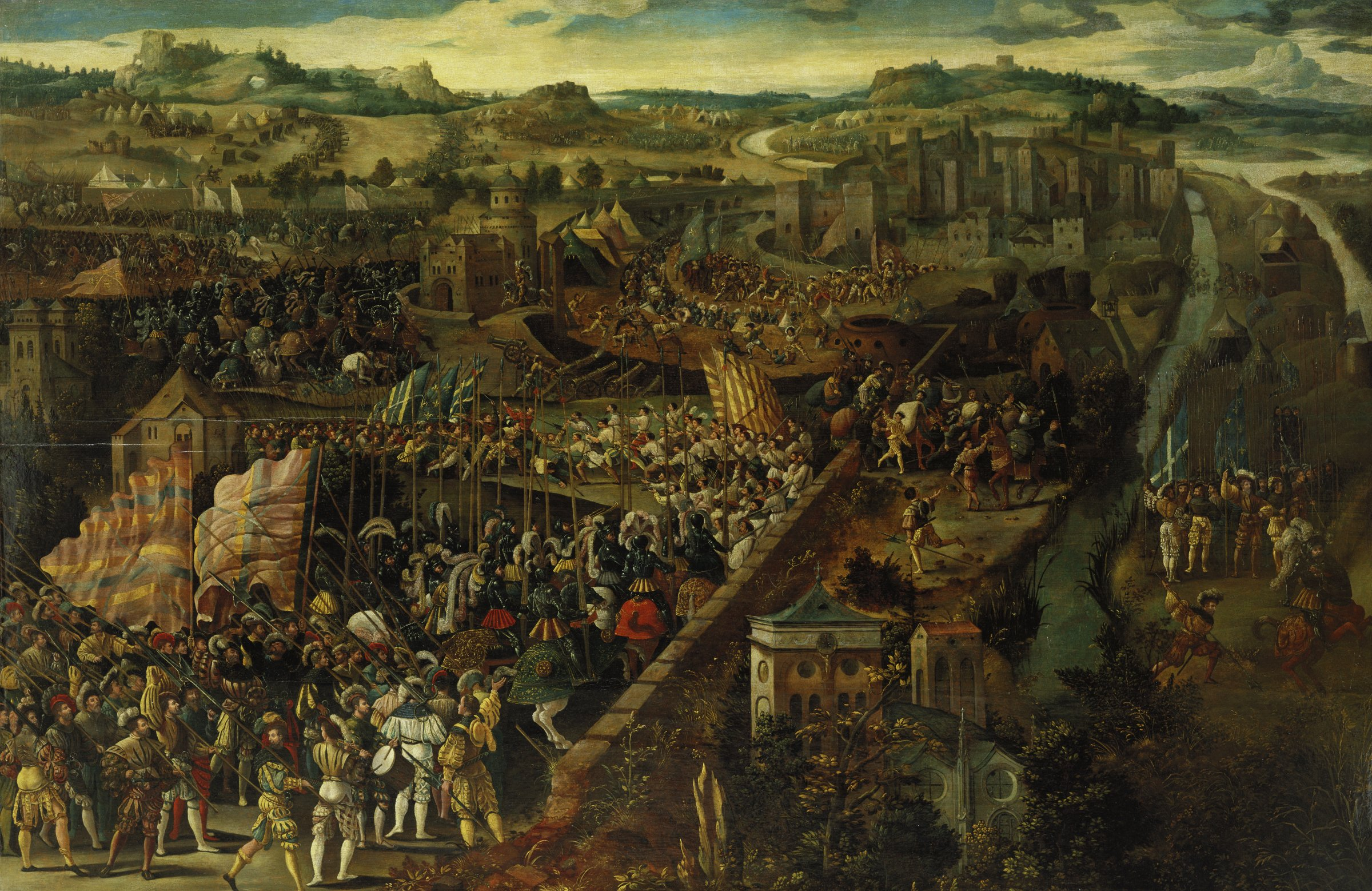 This painting captures a dramatic moment in a battle that took place in the town of Pavia in northern Italy where in 1525 the forces of the Hapsburg ruler Charles V, carrying pikes in the foreground, defeated the invading army of the French king, Francis I. Depicted from an aerial perspective, soldiers clash among the walls and building of the town. Flags wave, cannons smoke, and horses rear.