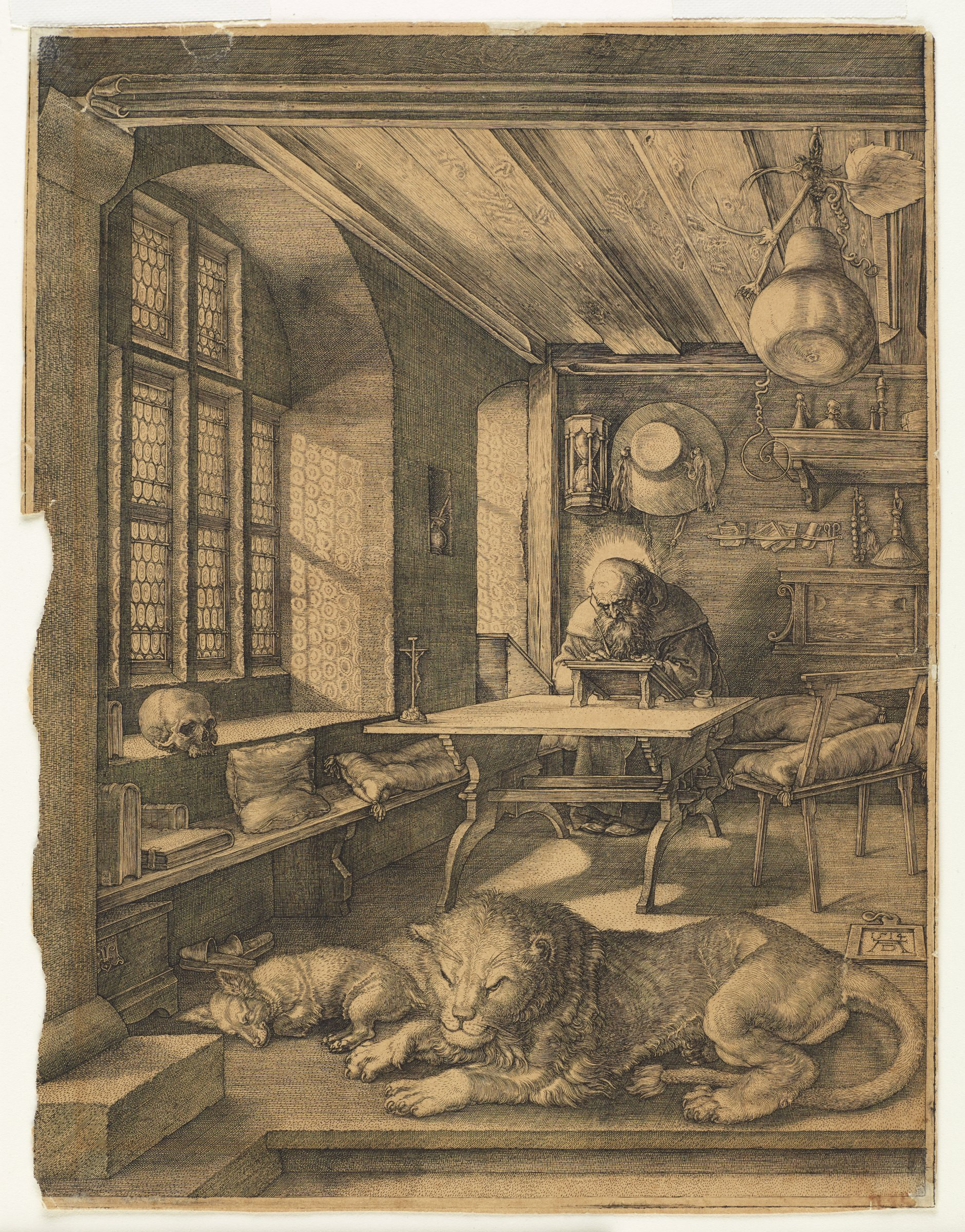 St. Jerome sits towards the back of a room at a desk.  A dog and a lion lay in the foreground.