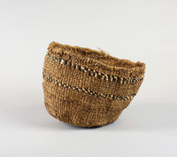 Crudely woven; large, coarse fibers; medium brown; two stripes, each with dark brown and natural alternating