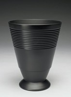 Tall black basalt vase of conical shape with round foot - Keith Murray shape number 3882 - the upper body incised with a series of engine-turned bands extending around the body.