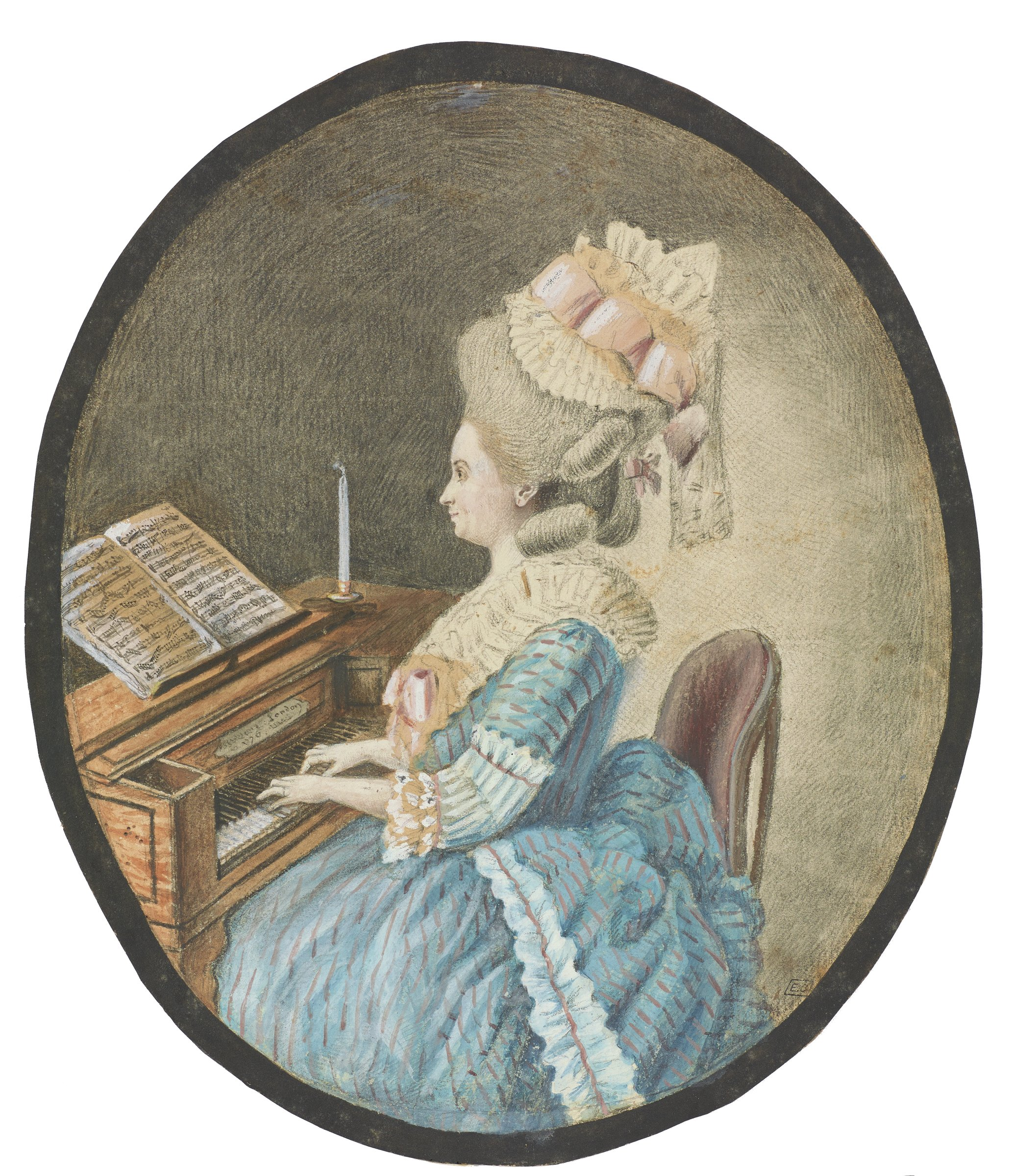 A woman wearing an elogant blue dress plays a clavier. She sits in profile facing the left.