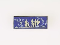 Rectangular dark blue jasper cameo with white relief of sacrificial scene with four male figures, set in silver as a brooch, two vertical cracks