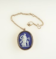 Oval dark blue jasper medallion with white relief of Venus and Cupid, set in gold and encircled in seed pearls as a pendant, with gold chain