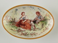 Small oval dish, painted with man, woman and dog