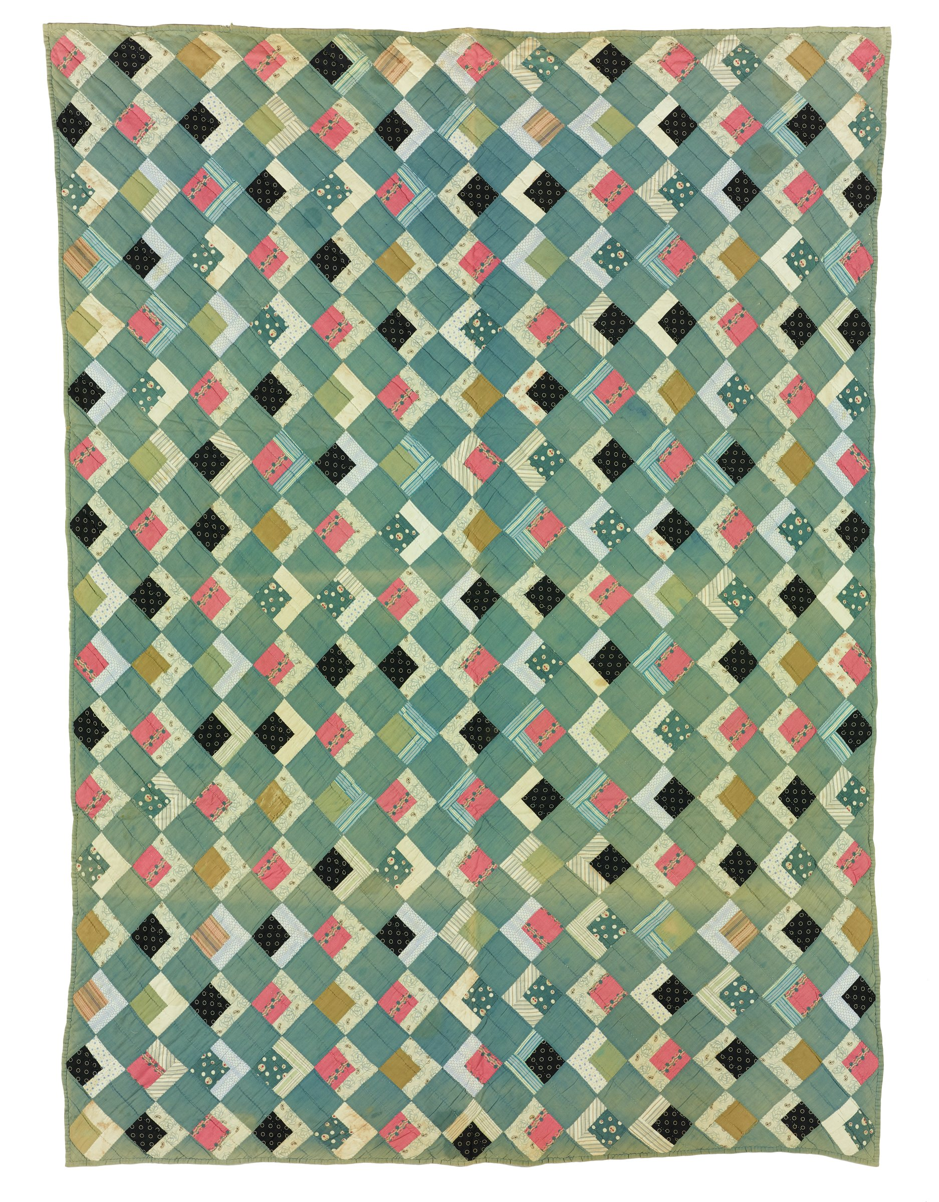 Large quilt of printed and plain cotton in a variation of the Log Cabin pattern, hand stitched and pieced with on the top a grid of squares on an angle of alternating solid teal green and colorful printed cotton, these each comprised of a smaller square and two rectangular pieces placed together in an L, the printed cotton in geometric, stripped, floral, and paisley patterns in shades of black, pink, blue, green, beige and brown, as well as plain white, the back of a woven unbleached cotton, edged in the same solid teal green cotton.