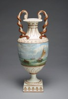 One of a pair of tall cream-colored, pearlware vases decorated in enamel colors and partially gilt, the gold a dark, brownish color, the small square base with a row of stylized anthemion motifs highlighted in gold, the foot with a border in a modified egg-and-dart pattern likewise picked out in gold, and the lower body of the urn-shaped vase with stylized, individually molded acanthus leaves outlined in gold; the main body of each vase is painted in the round with different delicate and very detailed seascapes that both show a gray and blue cloudy--almost stormy--sky over a choppy turquoise-blue sea, each scene includes a variety of ships with billowing sails, as well as groups of sailors in small row boats attempting to land ashore through rough, foamy waves, the sea also includes debris from the ships floating in the water, above each central scene is a band of overlapping leaves highlighted in gold, and the slender neck includes stylized foliate motifs outlined in gold and a band of beading around the lip; on each vase the two tall, slender, partially-gilt, scrolled handles has a slithery gold snake coiled around it, the snakes' heads rest on the shoulder of the vase.
