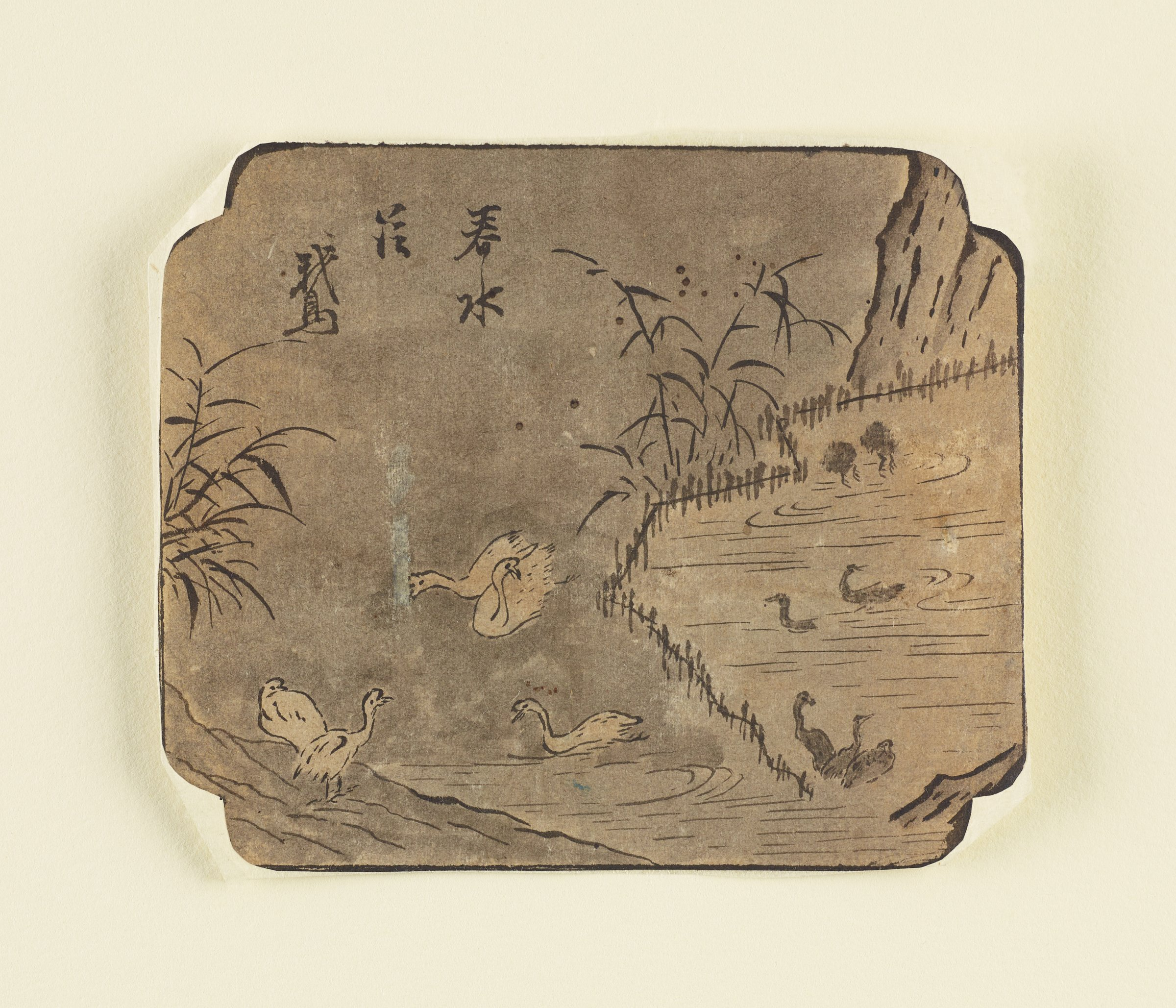 White and Black Swans Swimming and Nesting among Reeds in Cartouche FormatRectangular with indented rounded cornersThe V&A has one with a similar silhouette hypothesizes that it was intended as a portion for a folding screen.