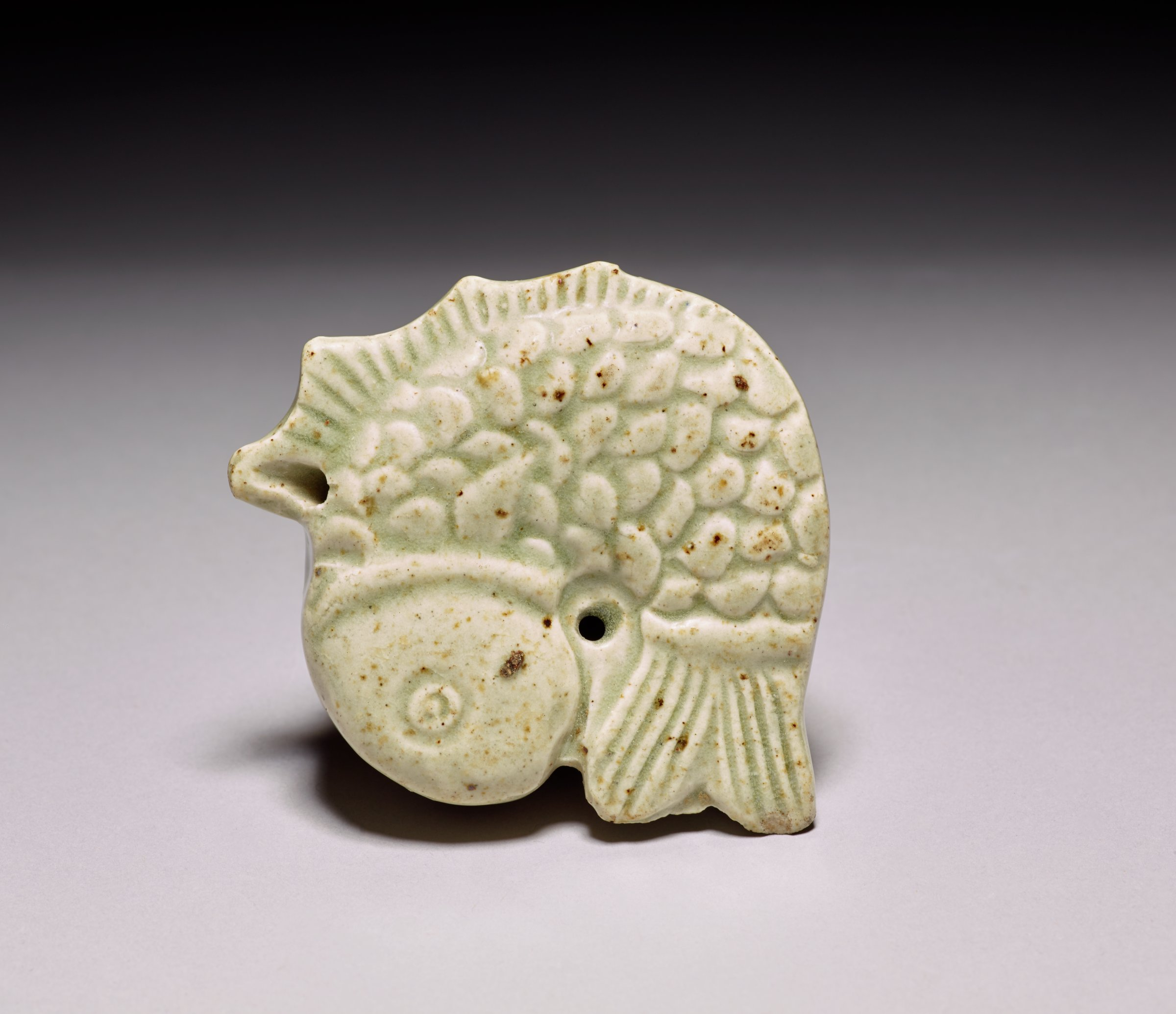 Fish-shaped water dropper, light celadon green.Lightweight, clean, probably 20th century