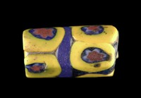Cylinder-shaped mosaic glass trade bead (millefiore), yellow, blue and red