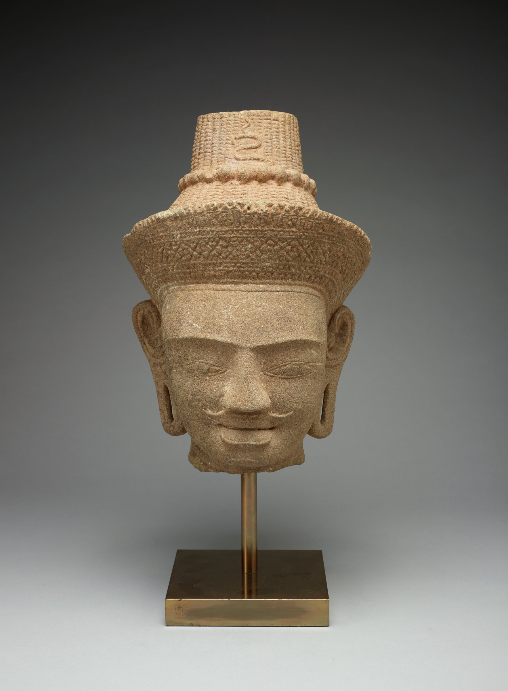 """Moustache, bear, elongated ears, ribbed eyebrows, floral crown and Head of Crowned Shiva Hair Marked by """"Om"""" Syllable"""